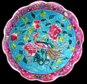 Qing porcelain made for  the Asian Market: Late 19th century very Large Famille Rose Green-Ground 'In and Out' Offering Dish (painted both inside and on the underside of the rim),